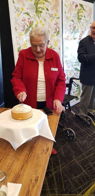 Pam cutting birthday cake